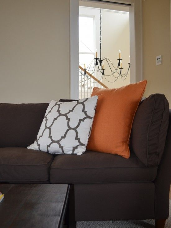 coral and neutral pillows for dark brown couch - what a great combo