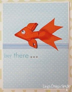 You can make a little fishy out of a few pieces of ribbon and add it to a gift, a card, a barrette...love it!