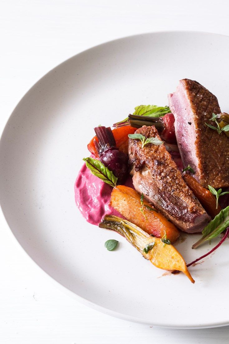 Adam Simmonds' delightful duck breast recipe is served on a bed of silky-smooth beetroot purée with an array of roasted autumn vegetables – the perfect dinner party dish.