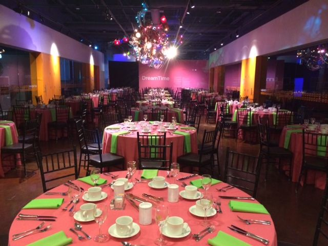 Pink and green table settings create the perfect compliment to Innovation Studios, and its ceiling sculpture, Dreamtime.