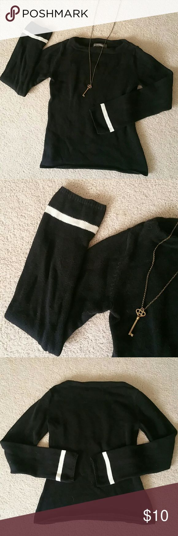 Banana Republic Black sweater This sweater is 100% cotton, with white accents Stripes at the wrist. This sweater is from the Banana Republic Factory Store. Very slight pilling to the armpits, otherwise excellent condition. Make an offer! Banana Republic Tops Sweatshirts & Hoodies
