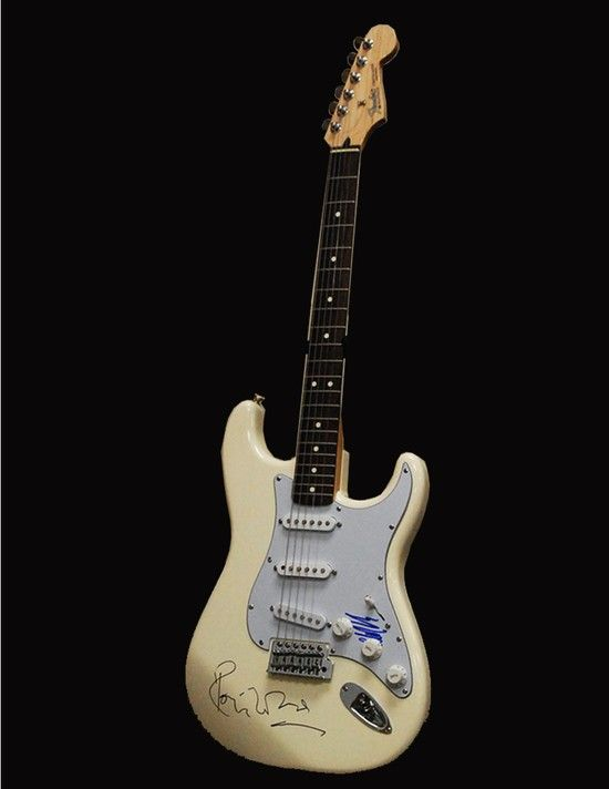 """Fender Stratocaster White Color Solid Body Electric Guitar Mahwah Museum Number:    2014.06.012 Description:     Fender Stratocaster White Color Solid Body Electric Guitar with autographed by Ron Wood and Mick Taylor of the Rolling Stones on body and pickguard. Series Number   Size:   13"""" W x 39"""" L x 2 1/2"""" H Owned by:   Private Collector Starting Bid: $500.00, Inc.: $100.00"""