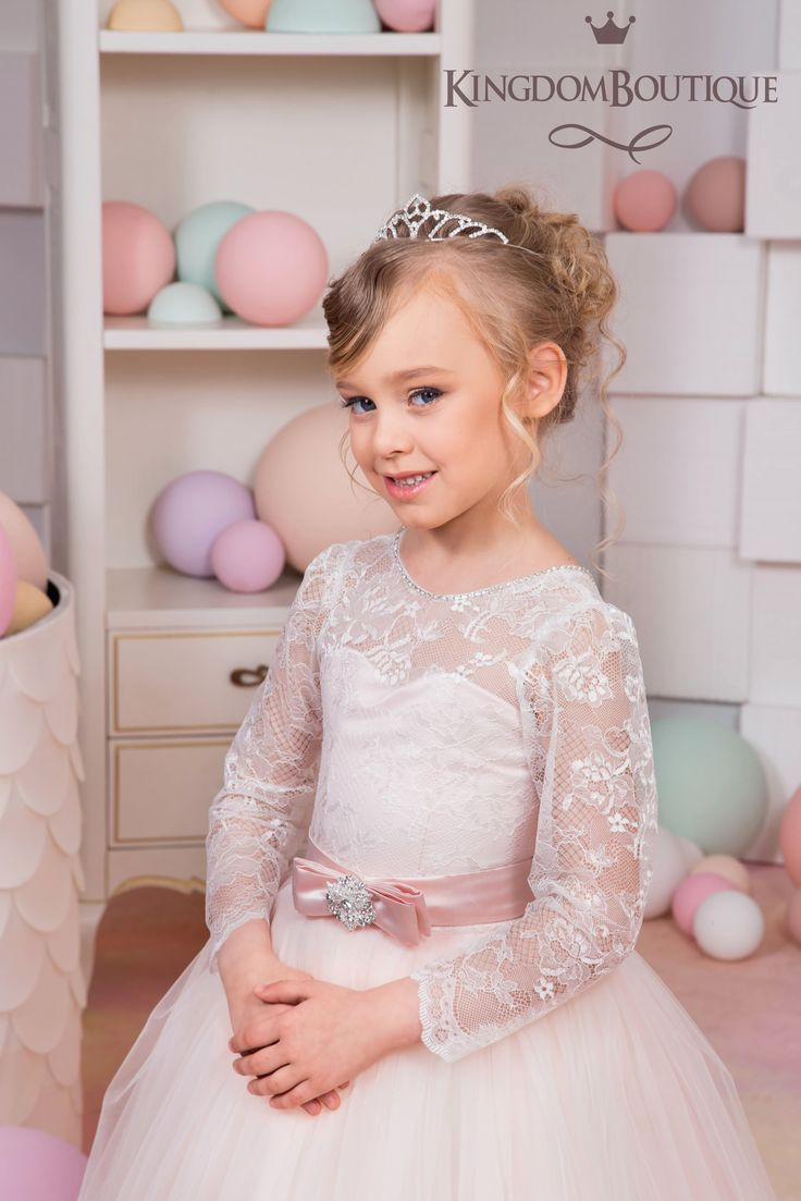 Gorgeous ivory and blush pink flower girl dress with multilayered skirt, lace corset with long lace sleeves, buttons, zipper and satin stripe with bow.   Item material:  upper layer of the skirt- tulle with lace applique middle layer of the skirt- tulle with lace applique lower layer of the skirt- taffeta corset- lace, satin.