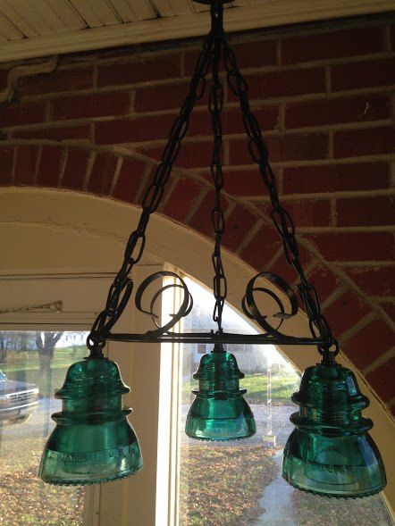 I wanted to make a hanging light fixture using vintage electric insulators.  My husband jumped on board and designed, tack welded, painted and came up with thes…
