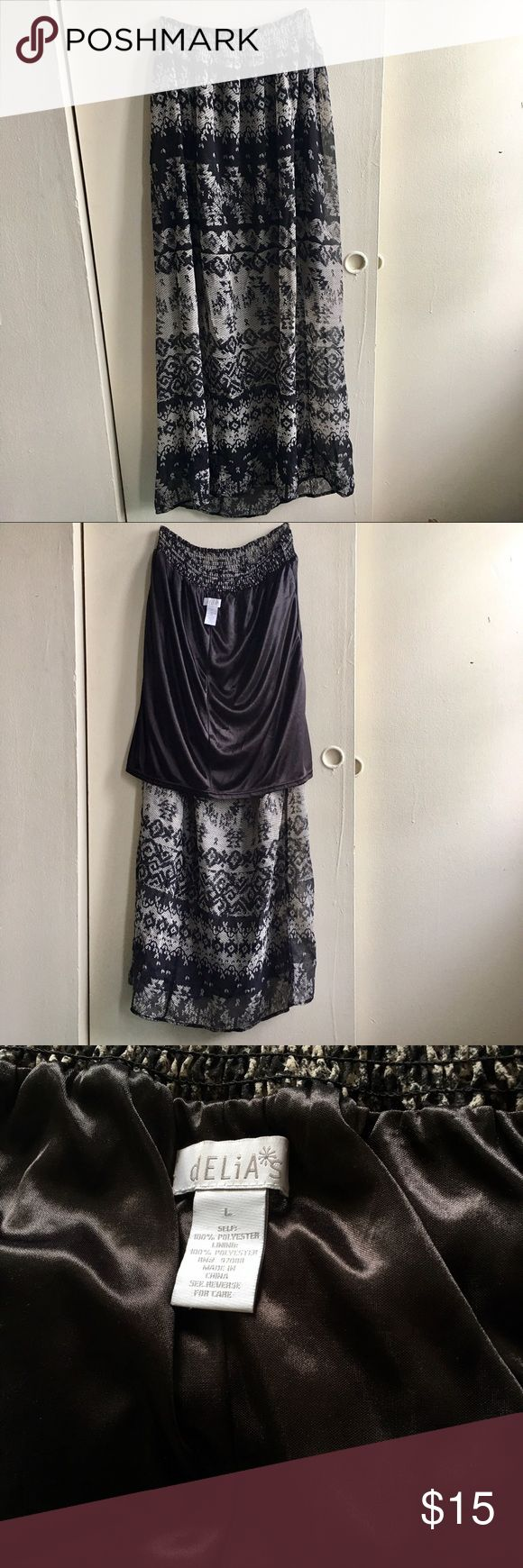 """Delia's Lovely Print Skirt 🌼 Women's Size L (According to Delia's size chart  Sizes 11-14 Hips: 39""""-41"""") Short black skirt underneath to protect see-through (see second photo)  Breezy, light, and perfect for warmer weather ☀️  I'm 5'2 and length is good and waistband is stretchy for comfy fit (:  Feel free to make offers . . #maxiskirt #longskirt #skirt #tribalprint #sweet #womenslarge #teen #summerfashion #springfashion Delia's Skirts Maxi"""