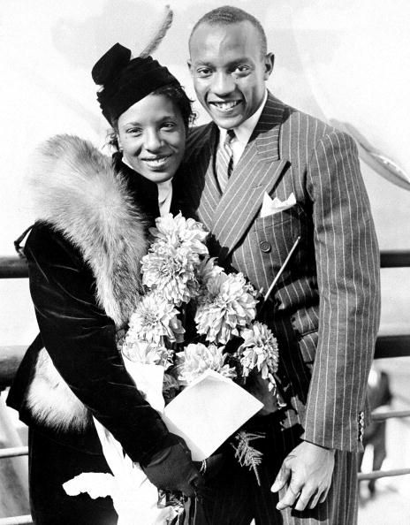 "Olympic icon Jesse Owens and his wife, Ruth Owens, return home from the Olympics in Berlin on August 24, 1936. The son of a sharecropper and grandson of slaves, the Oakville, Alabama-born Mr. Owens won a record 4 gold medals at the 1936 games, annihilating the racist myth of white superiority in the presence of Adolph Hitler. Mr. Owens stated after his victories, ""When I came back to my native country, after all the stories about Hitler, I couldn't ride in the front of th"