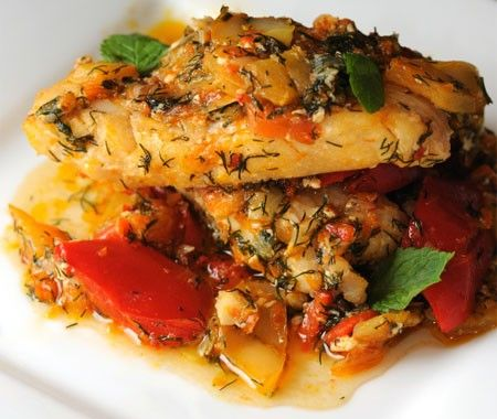 A traditional South African seafood dish topped with a tomato and onion sauce. Serve with other African favourites for a Zwanzaa dinner.