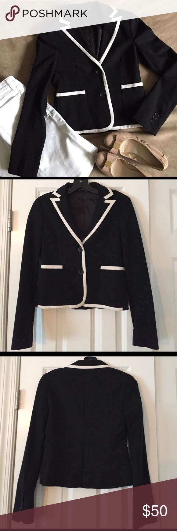 Theory Black Blazer with White Piping size 0 Theory Black Blazer with White Piping.  Size 0.  Blazer is super comfortable, feels like a jersey knit in.  Has 3 button Detail on sleeves.  White Piping on collar, bottom, pockets, and front of jacket.  Two button closure on front.  Darts on front of Jacket to provide a slimming look.  Worn twice. Theory Jackets & Coats Blazers