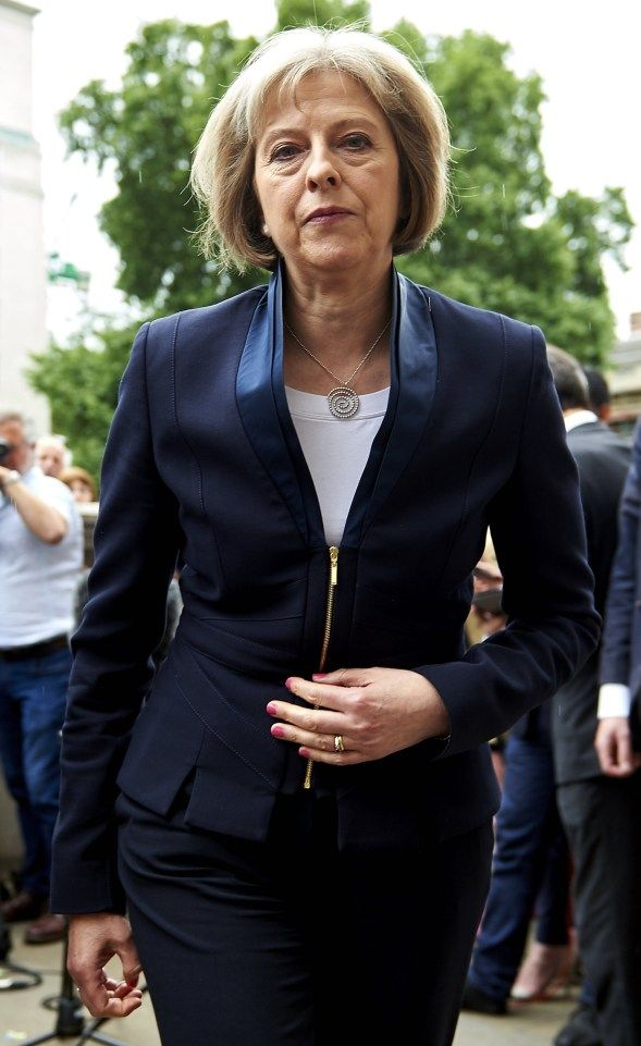 British Home Secretary Theresa May is pi
