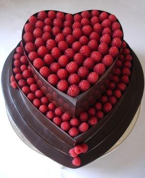 Dark chocolate heart cake with raspberries by nickygrant