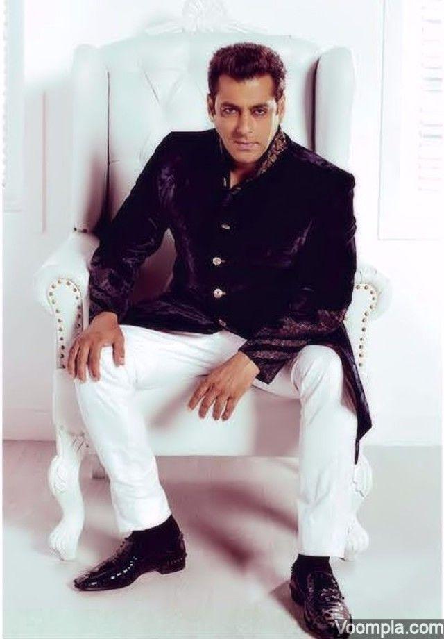 Salman Khan channels a royal traditional style in a velvet JJ Valaya jacket, white Raghavendra Rathore pants and black Christian Louboutin shoes. via Voompla.com