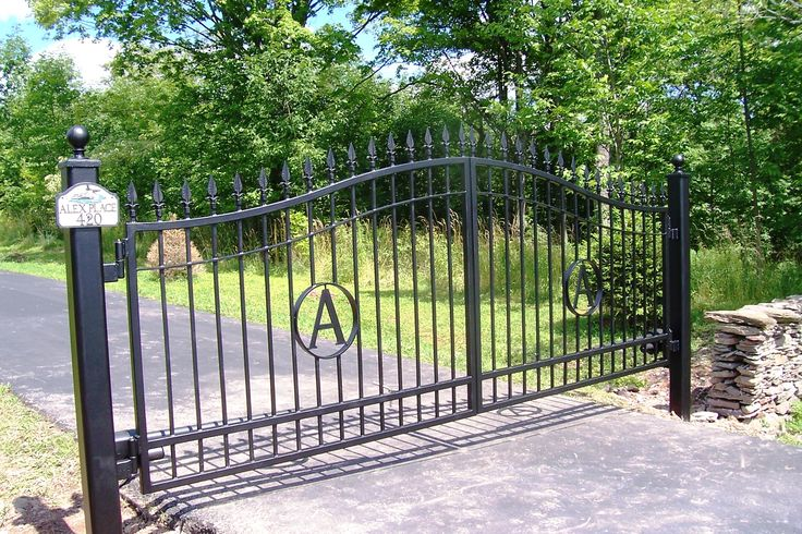 1000 images about iron garage doors and gates on for Garage fence