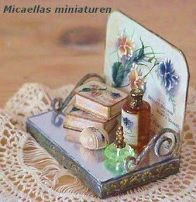 this lady has a TON of miniatures and directions on how to make them...Great blog ! how to: vanity display (with printables)