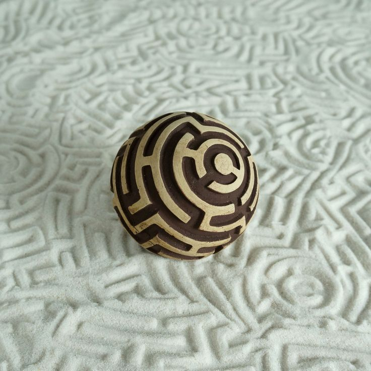 The Maze is A-Mazing! Corny puns aside, this sphere has a real maze on it, complete with an entrance and exit. Each Olander Earthworks sand sphere is hand-cast & individually pigmented by our small te