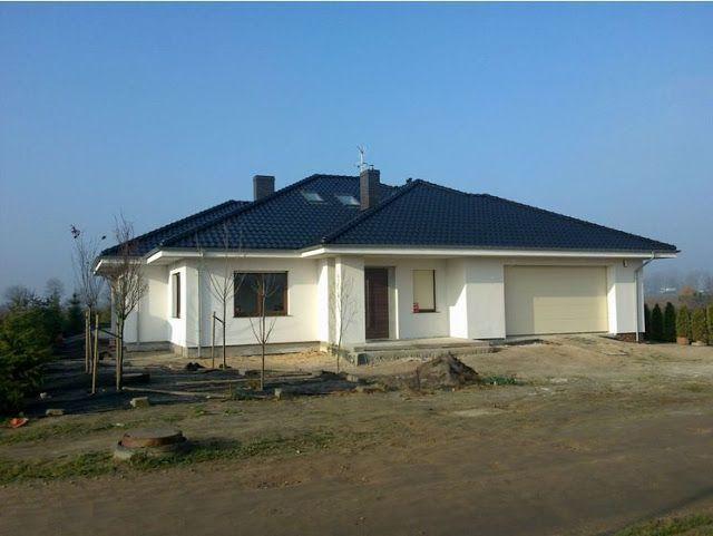 Elewacje Zuzzy: Ciemne dachy ciemne okna