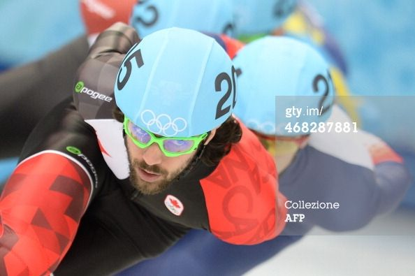 Canada's Charles Hamelin competes in the Men's Short Track 1500 m Heats at the Iceberg Skating Palace during the Sochi Winter Olympics on Fe...
