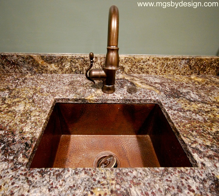 Orite Granite with a Leathered Finish on a Theater Bar.  Hammered Copper undermount bar sink.