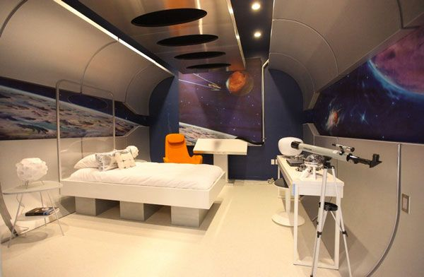 A kid's spaceship room with a telescope