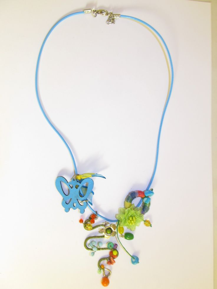 Handmade short leather necklace (1 pc)  Made with turquoise leather butterfly, handmade spiral motif with green wire, metal flower and glass beads, fiber hoop, fabric flower, ribbons and wax cords.