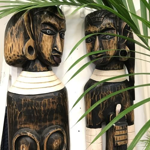 Hand carved Ethnic style Native couple.  Sold as a pair/set, this statement wall piece will work perfectly in your home to bring out that British Colonial interior style or to give a tropical feel.