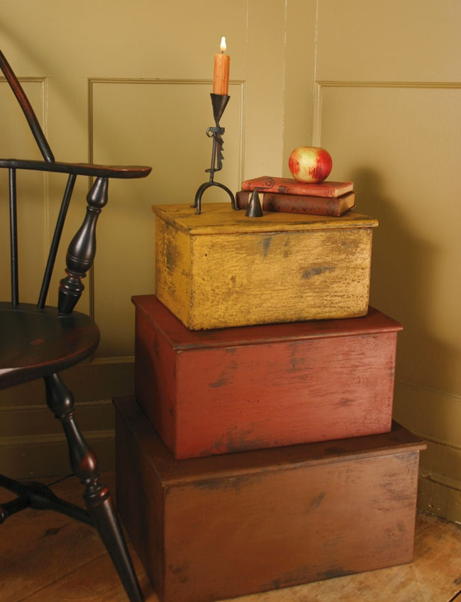 stack of trunks...and a glimpse of a windsor chair.