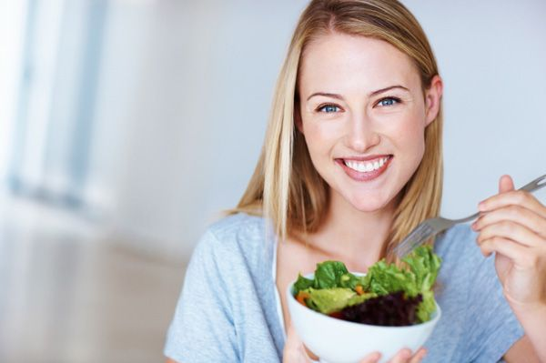 happy-woman-eating-salad-600