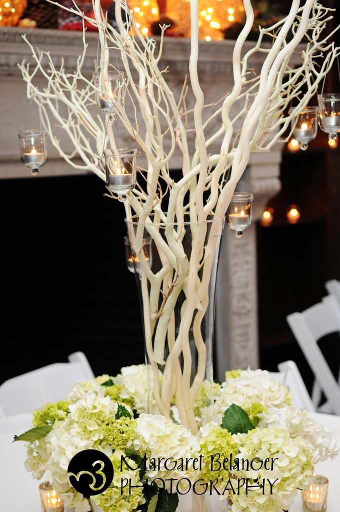 Jackie eckhoff candles hanging from branches wedding