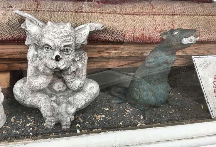 A bored gargoyle and an anxious rat at an antiques store in South Orange, NJ