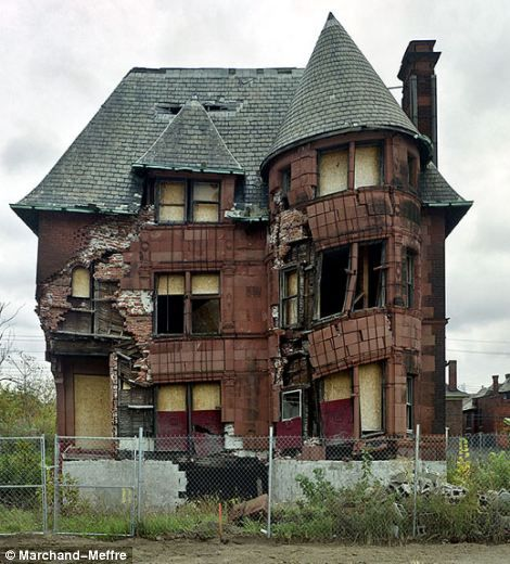 Dying Detroit: Haunting photos of crumbling neighbourhoods highlight the terrible decline of America's once-great Motor City