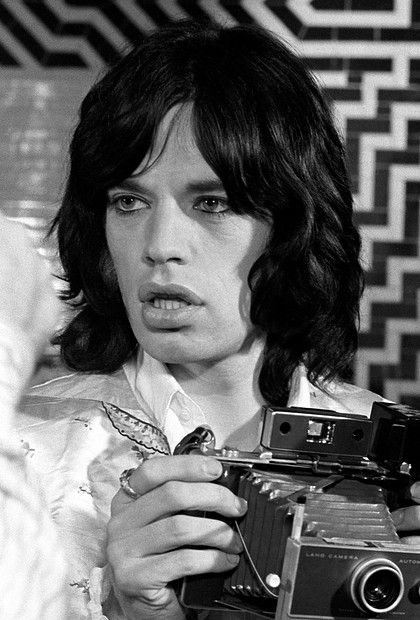 Ahh!!  I have this photograph framed in my office.  Mick Jagger...soft force of nature.