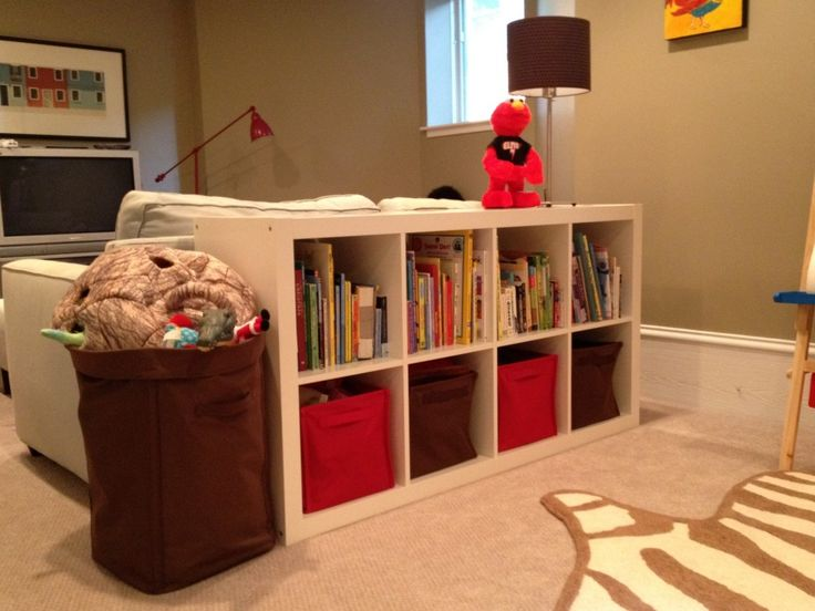 Expedit 8 square system used as console behind couch--with land of nod canvas storage bins