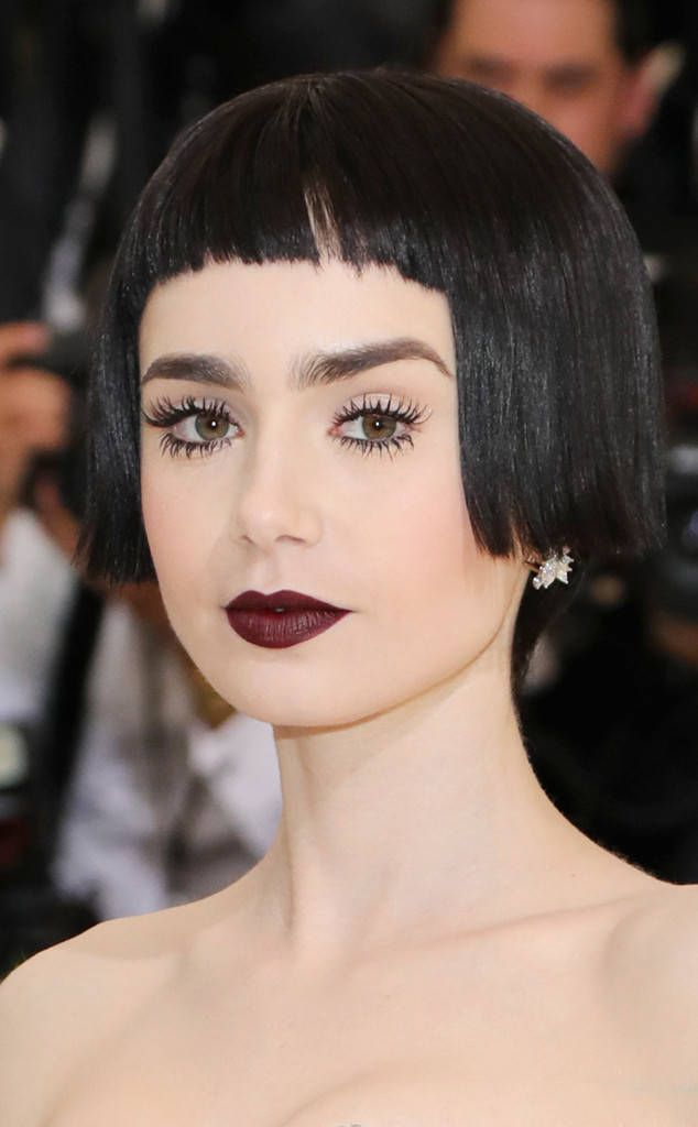 Lily Collins from 2017 Met Gala: Best Beauty  The actress went all out with her film-noir inspired beauty. The short cut, wispy lashes and wine-hued lips made it the total package.