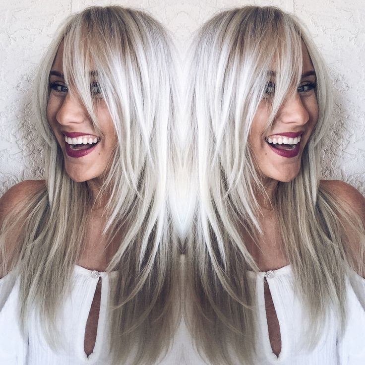 Long fringed bangs. Bridget Bardot inspired blonde hair. Icy cool silver blonde color by Erica at House Of Cabelo using R+Co, Olaplex, Redken, and Oribe