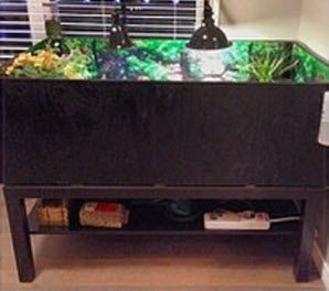 A regular coffee table can easily be turned into a for Coffee table enclosure
