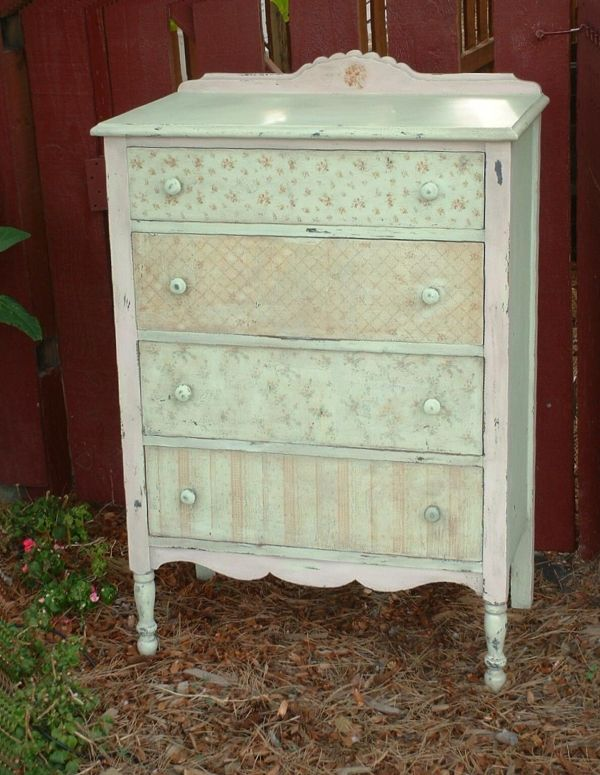 Painted antique dresser with drawer fronts covered with fabric. This is a cute, shabby chic dresser!