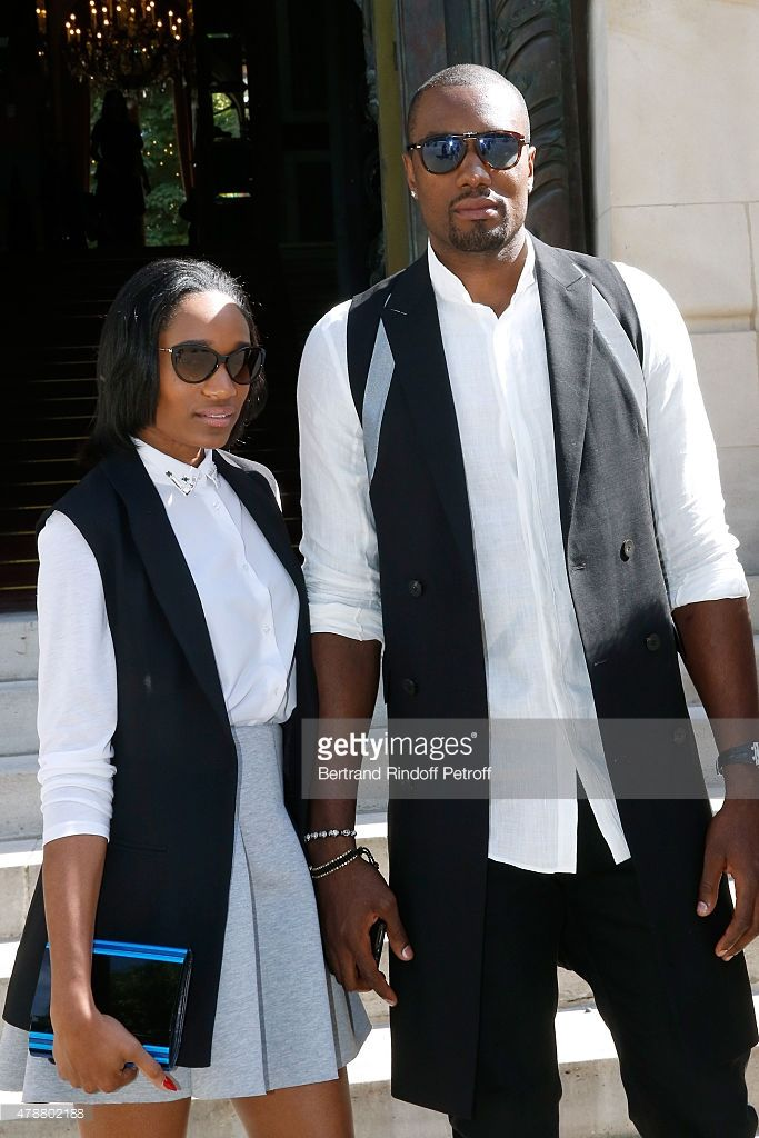 Basketball Player Serge Ibaka and his wife attend the Balmain Menswear Spring/Summer 2016 show as part of Paris Fashion Week on June 27, 2015 in Paris, France.