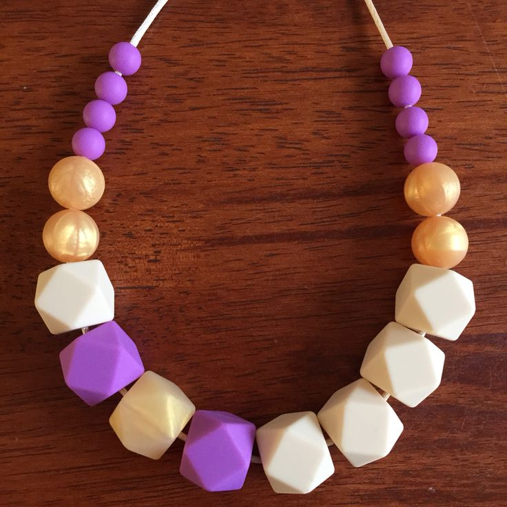 Fussy Little Fox Geo Hexagon Teething Necklace in vanilla, lavender and honeycomb on vanilla nylon cord with gold safety catch. $27 + Free Shipping within Australia. Visit Fussy Little Fox on Facebook or email fussylittlefox@gmail.com to order! #fussylittlefox #bpafree #nontoxic #siliconeteethingnecklace #teething #soregums #baby #dribble #mum #fashion #necklace #chew #oralsensory #sensorychew #fussy #fussybaby #handmade #handmadewithlove