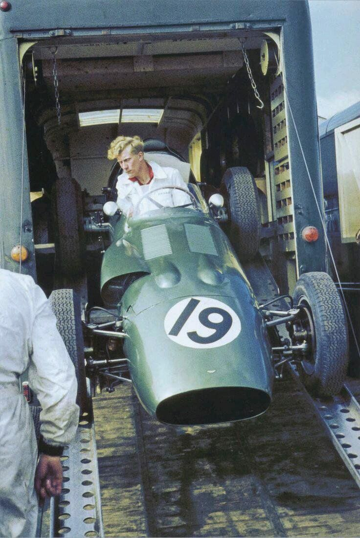 A mechanic unloading Maurice Trintignant's Aston Martin at the 1960 British Grand Prix, Silverstone.
