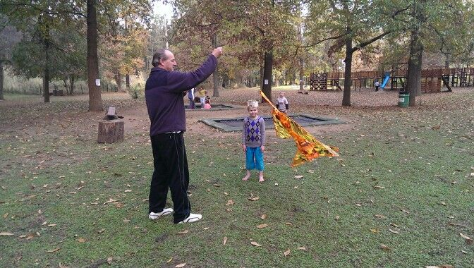 Father teaching his son how to fly a kite <3