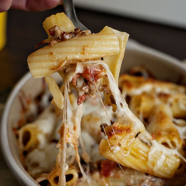 Pasta Al Forno recipe. This sounds delicious! Italian Sausage, creamy sauce,  tomato sauce, fresh basil, and mozzarella. Might not be low-fat but it sounds like perfect comfort food!