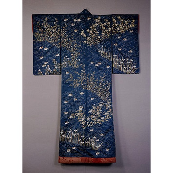 1820-1860, The combination of delicate embroidery and dark blue satin fabric give this kimono a striking, lustrous appearance. This kimono has a design of ducks on rippling water among flowers. Paired ducks are a symbol of marital harmony, so this kimono may have been part of a wedding trousseau.
