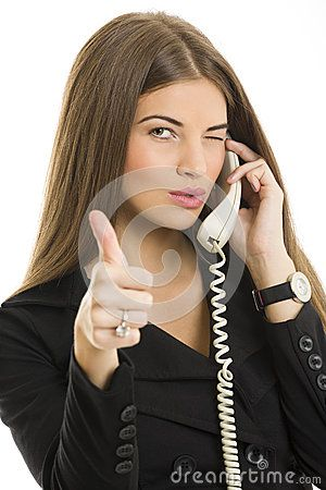 Portrait of attractive young business woman gesturing okay sign while talking on phone over white background.