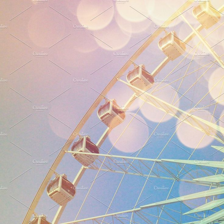 Ferris wheel with abstract bokeh by Nuchylee Photo on @creativemarket