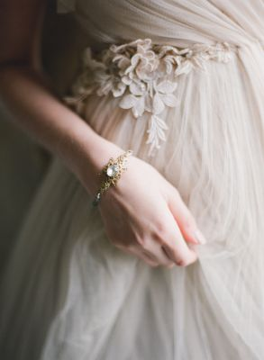 Bride wearing a very pale pink/ivory tulle dress and gold birdcage veil. Fine art film wedding photography by Taylor and Porter.