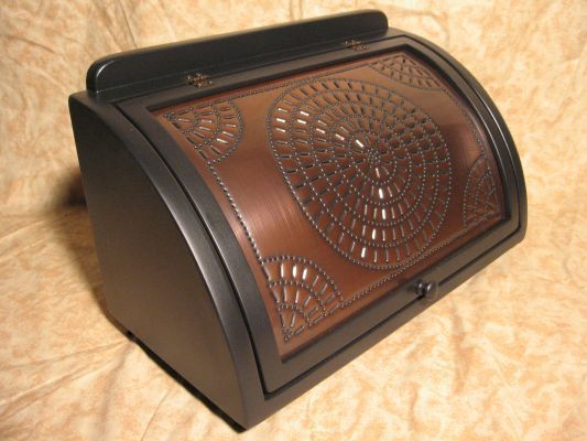A popular copper punched panel southwestern style 1 1/2 loaf bread box.