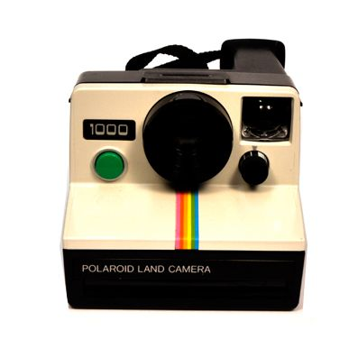 VINTAGE NON-FOLDABLE SX-70 camera, c. 1980. Took instant photos, which slid out covered in Mylar film to develop in seconds, after which you peeled it off to get the finished image.