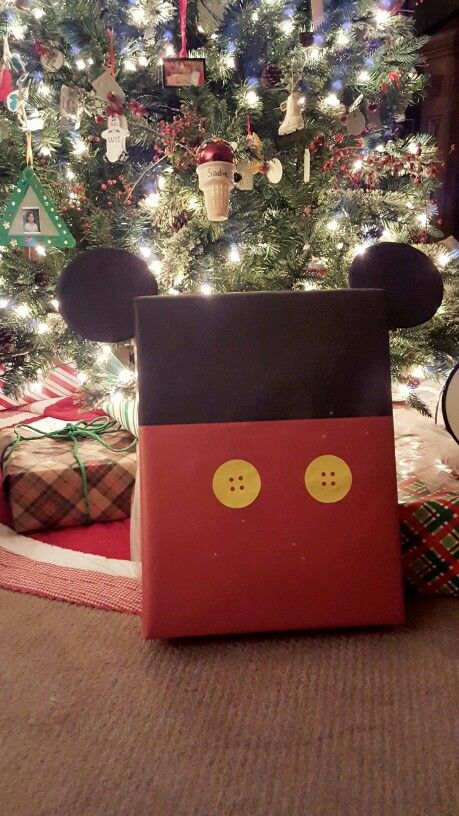 Disney World trip reveal Christmas gift. Inside is a letter announcing our trip, a travel guide, calendar to count down the days, and other assorted Disney related surprises