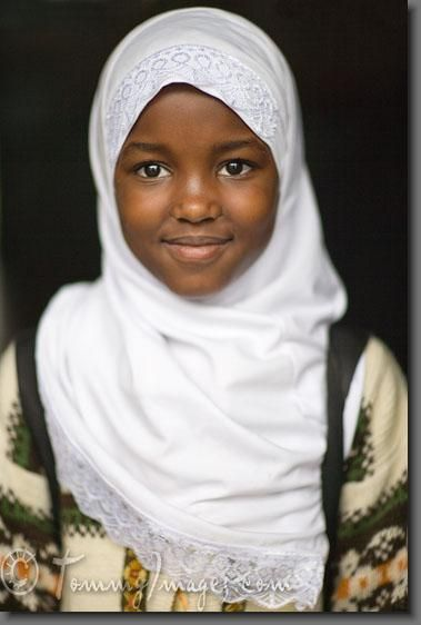 Arusha, Tanzania - Photo of a young African girl in a headscarf. Approximately 35% of the population in Tanzania is Muslim, mostly concentrated along the coast where the Arabic influence is greater. However there is still a significant Islamic presence in the interior towns such as Arusha. Pic Source: http://tommyimages.com