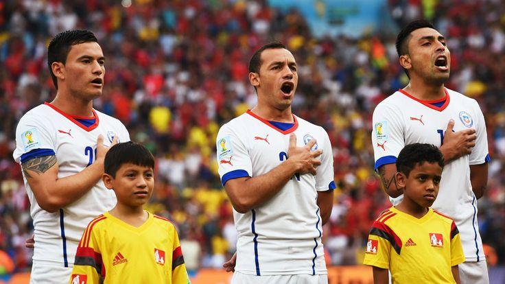 Charles Aranguiz, Marcelo Diaz and Gonzalo Jara of Chile sing the National Anthem