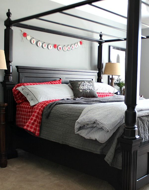 """A """"very merry"""" banner and plaid bedding makes this Christmas bedroom feel extra cozy."""